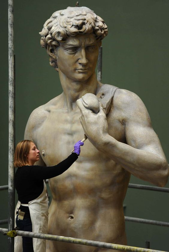 culpture conservator Johanna Puisto unveils a cast of Michaelangelo's David at Victoria & Albert Museum in London.jpg